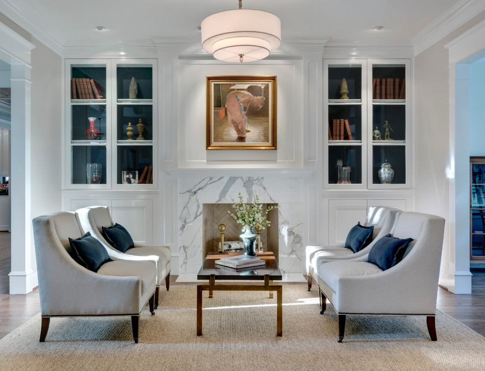 Elegant formal living room photo in Dallas with a standard fireplace