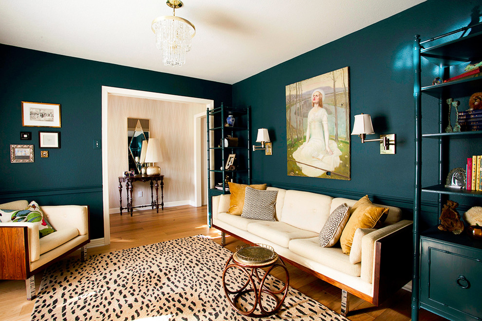 Eclectic enclosed medium tone wood floor living room photo in Austin with blue walls