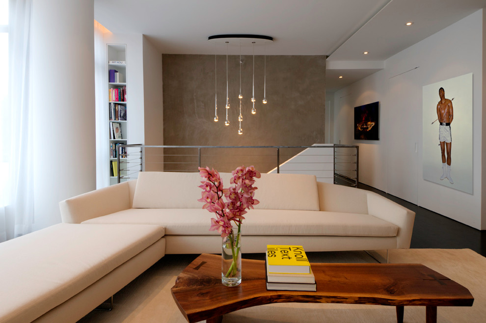 Inspiration for a modern loft-style living room remodel in New York with white walls