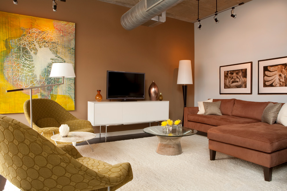 Mid-century modern living room photo in DC Metro with brown walls and a tv stand