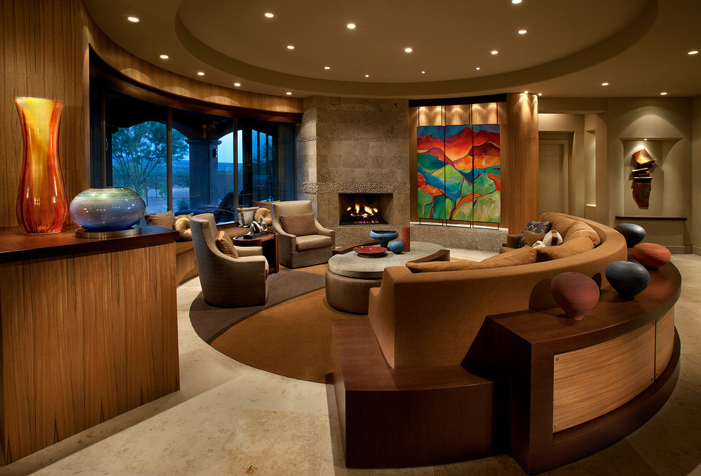 Living room - large contemporary open concept living room idea in Phoenix with a standard fireplace, beige walls and a concealed tv