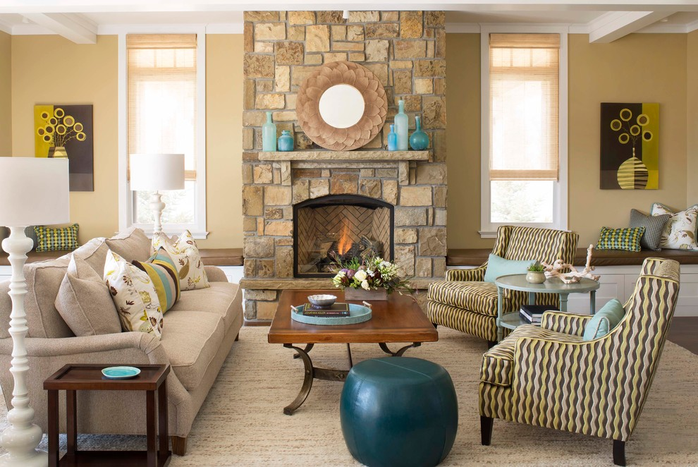Trendy living room photo in Denver with yellow walls, a standard fireplace, a stone fireplace and no tv