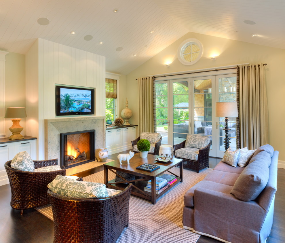 Elegant living room photo in San Francisco with beige walls and a wall-mounted tv