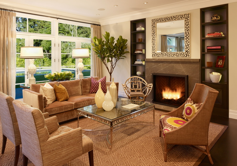 Example of a classic living room design in San Francisco with beige walls and a standard fireplace