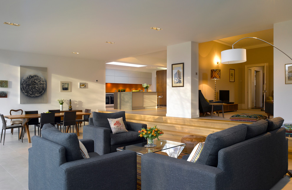 Large contemporary living room in London with white walls, no fireplace and no tv.