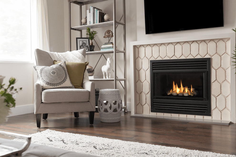 Inspiration for a mid-sized contemporary open concept dark wood floor and brown floor living room remodel in Boston with white walls, a standard fireplace, a tile fireplace and a wall-mounted tv