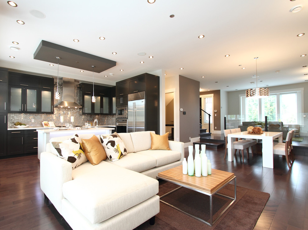 Inspiration for a contemporary open concept living room remodel in Vancouver with gray walls