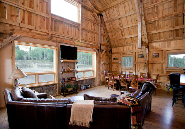 Various barn home interiors traditional living room for Post and beam living room ideas