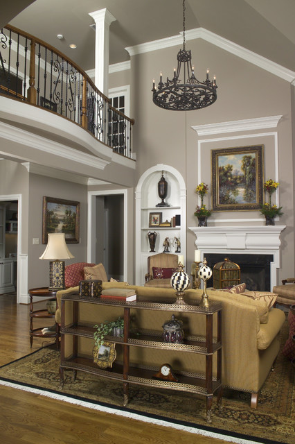 Vaulted family room with balcony traditional living for Balcony living room design