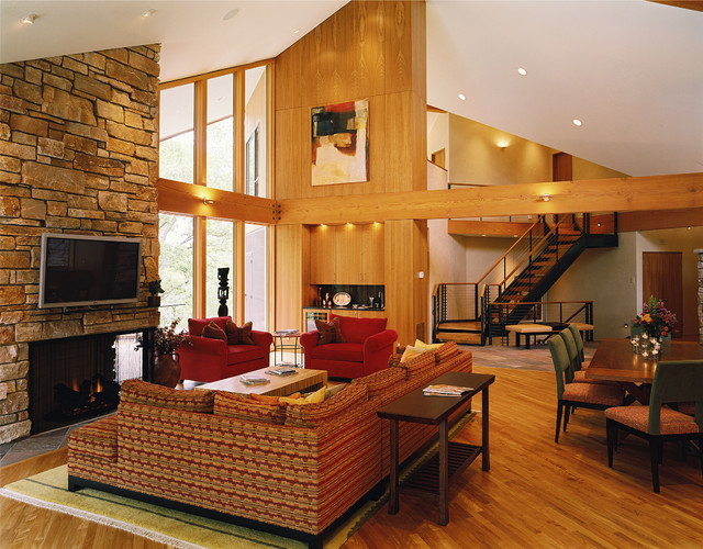 Vaulted Living Room With Stone Fireplace And Beams