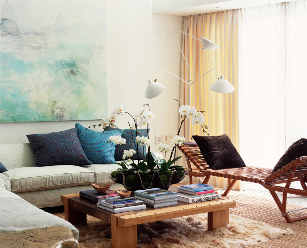 Example of a mid-sized trendy formal living room design in Los Angeles with beige walls, no fireplace and no tv