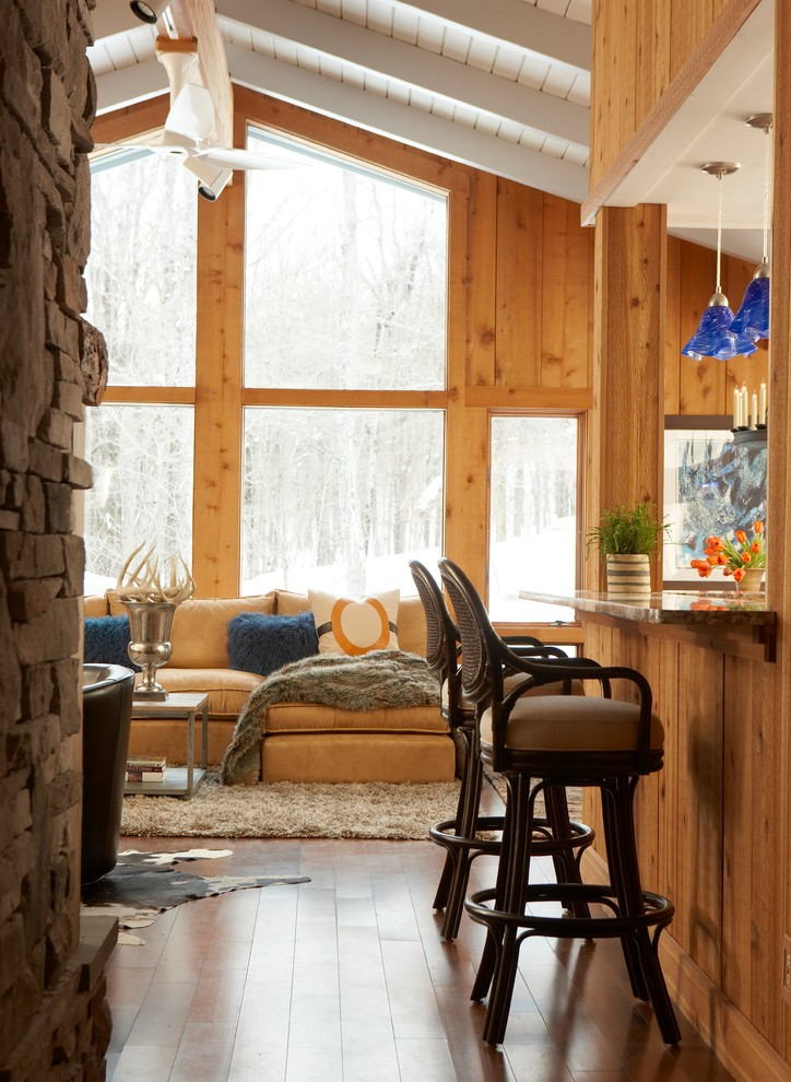 Inspiration for a mid-sized craftsman formal and open concept medium tone wood floor living room remodel in New York with brown walls, no fireplace and no tv