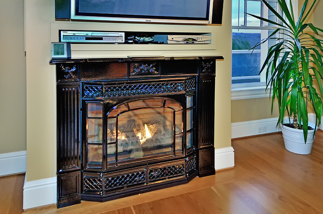 This fireplace is the perfect blend of elegance and high tech heating performance. Custom home built by Mystic River Building Company. Mystic