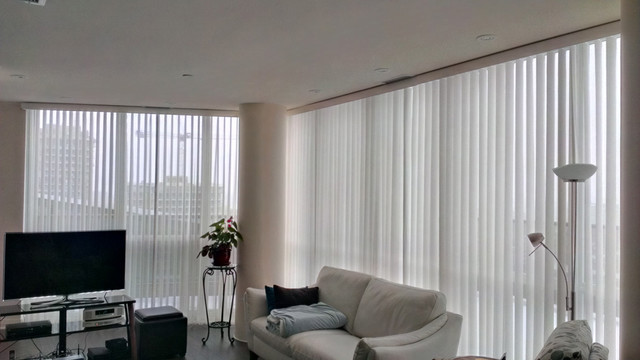 Vertical blinds in a condo modern living room for Living room vertical blinds