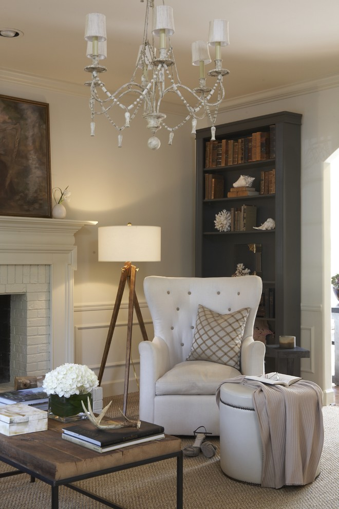 Example of a classic living room design in Birmingham with a standard fireplace and a brick fireplace