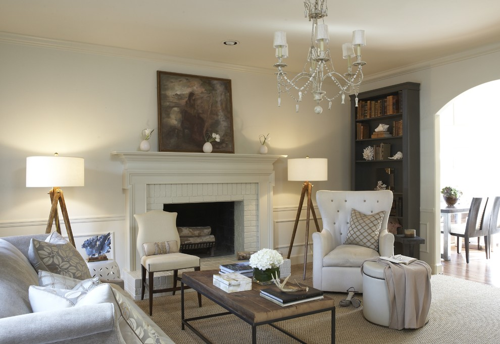 Living room - traditional living room idea in Birmingham with a brick fireplace