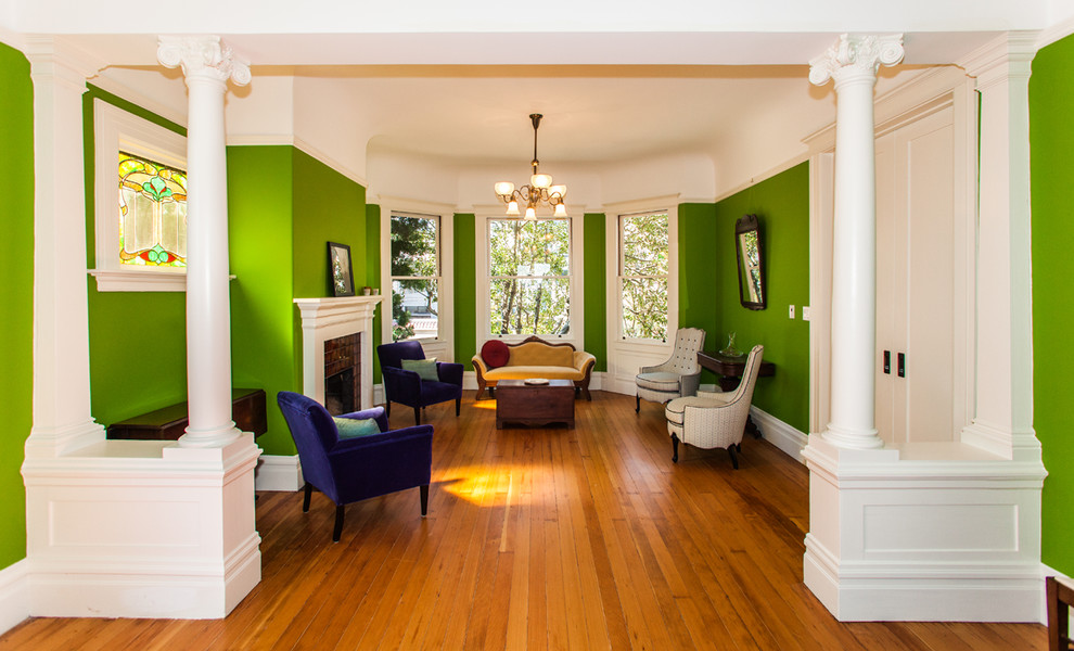 Living room - victorian living room idea in San Francisco with green walls