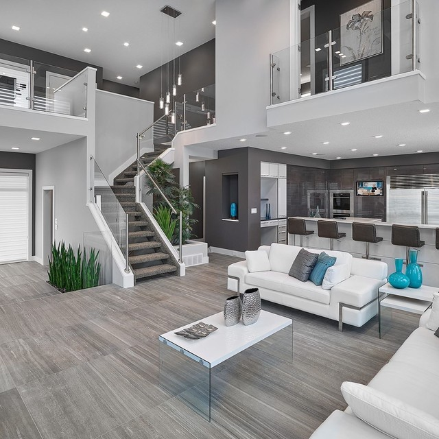 inspiration for a contemporary open concept gray floor living room remodel in edmonton with gray walls