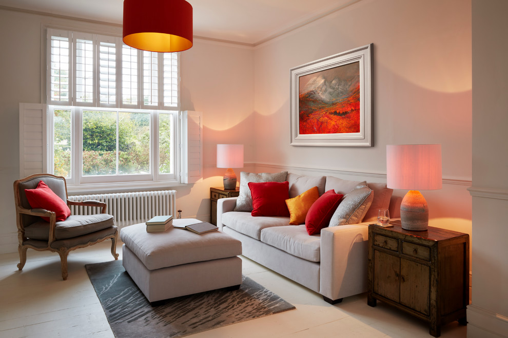 Example of a trendy formal painted wood floor living room design in Kent with white walls