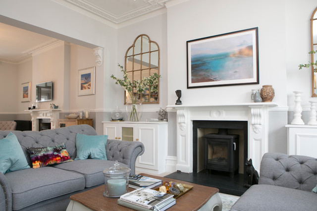 Example of a large transitional open concept and formal carpeted living room design in Dorset with gray walls, a wood stove, a stone fireplace and no tv
