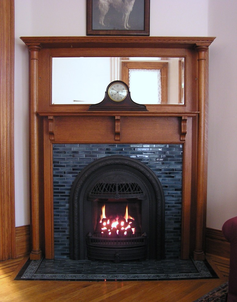 Example of an ornate living room design in Minneapolis with a corner fireplace, a tile fireplace and purple walls