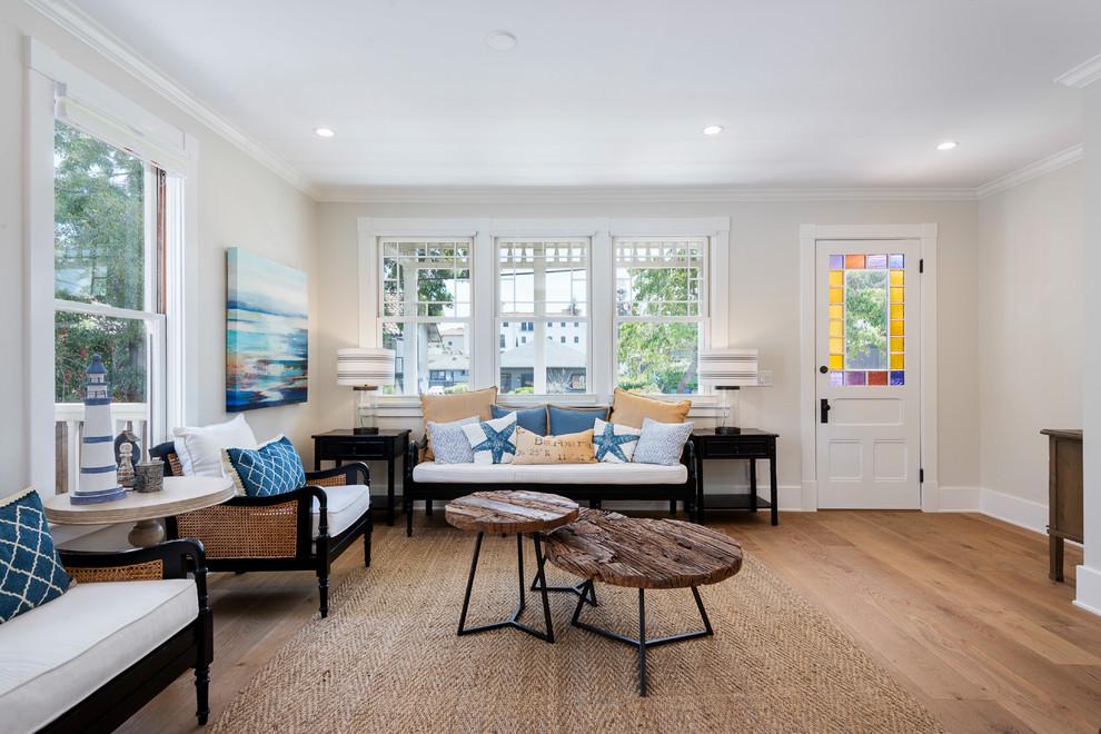 Living room - large beach style open concept medium tone wood floor and brown floor living room idea in Santa Barbara with beige walls