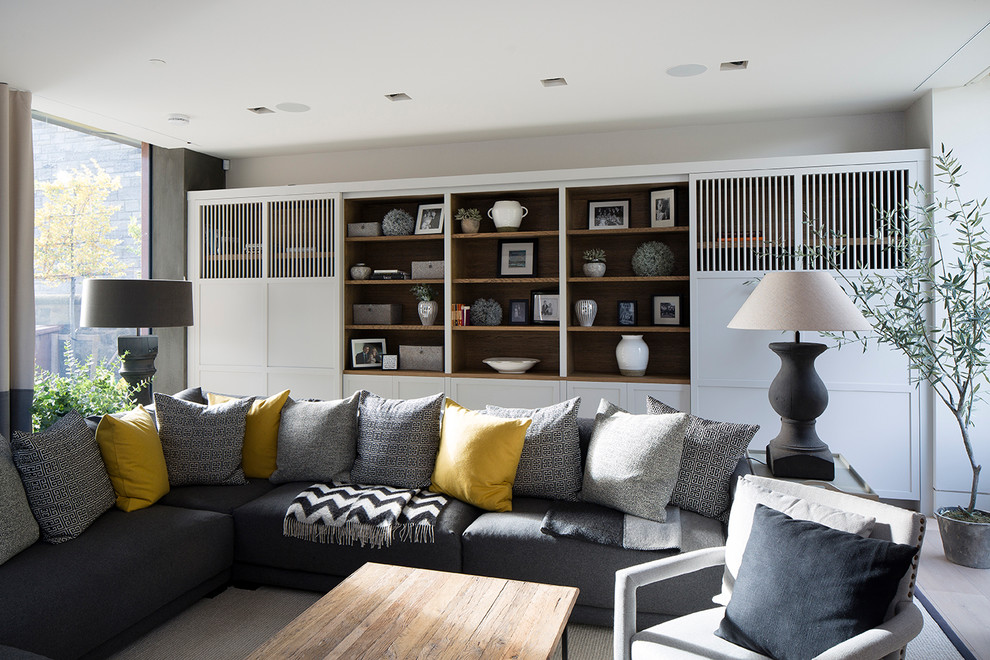 Example of a mid-sized trendy enclosed carpeted living room design in Edinburgh