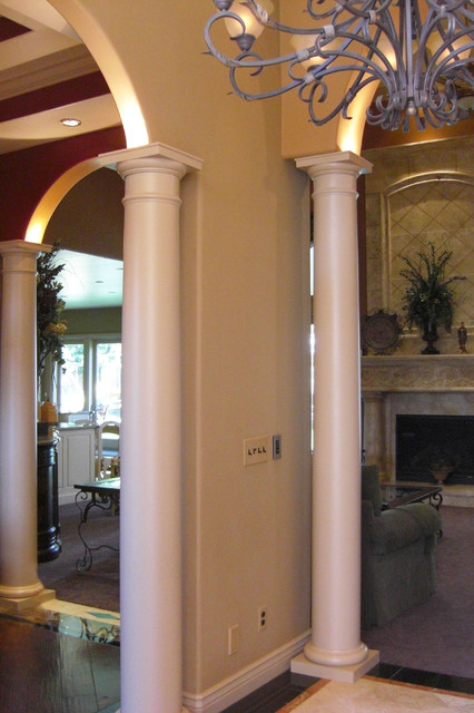 View of dining and living room with classical columns for Family room columns