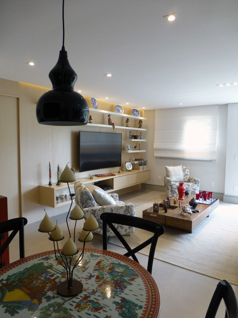 Example of a mid-sized trendy open concept porcelain floor living room design in Other with beige walls and a wall-mounted tv