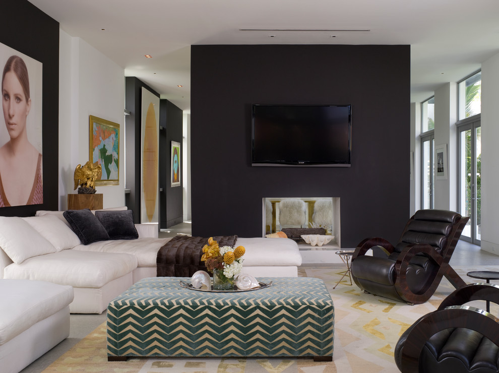 Inspiration for a contemporary living room remodel in Miami with a two-sided fireplace