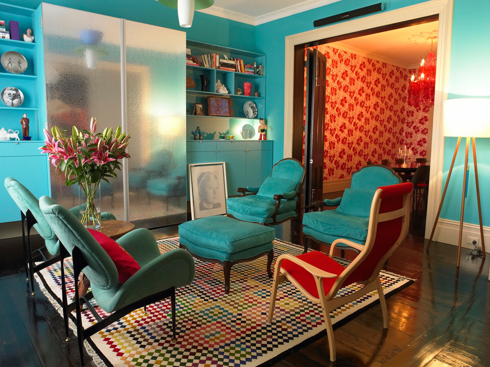 Living room - mid-sized eclectic dark wood floor living room idea in Sydney with blue walls