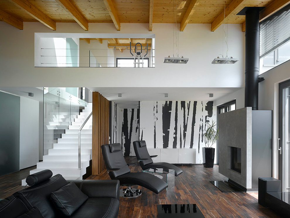 Example of an urban open concept dark wood floor living room design in Other with multicolored walls