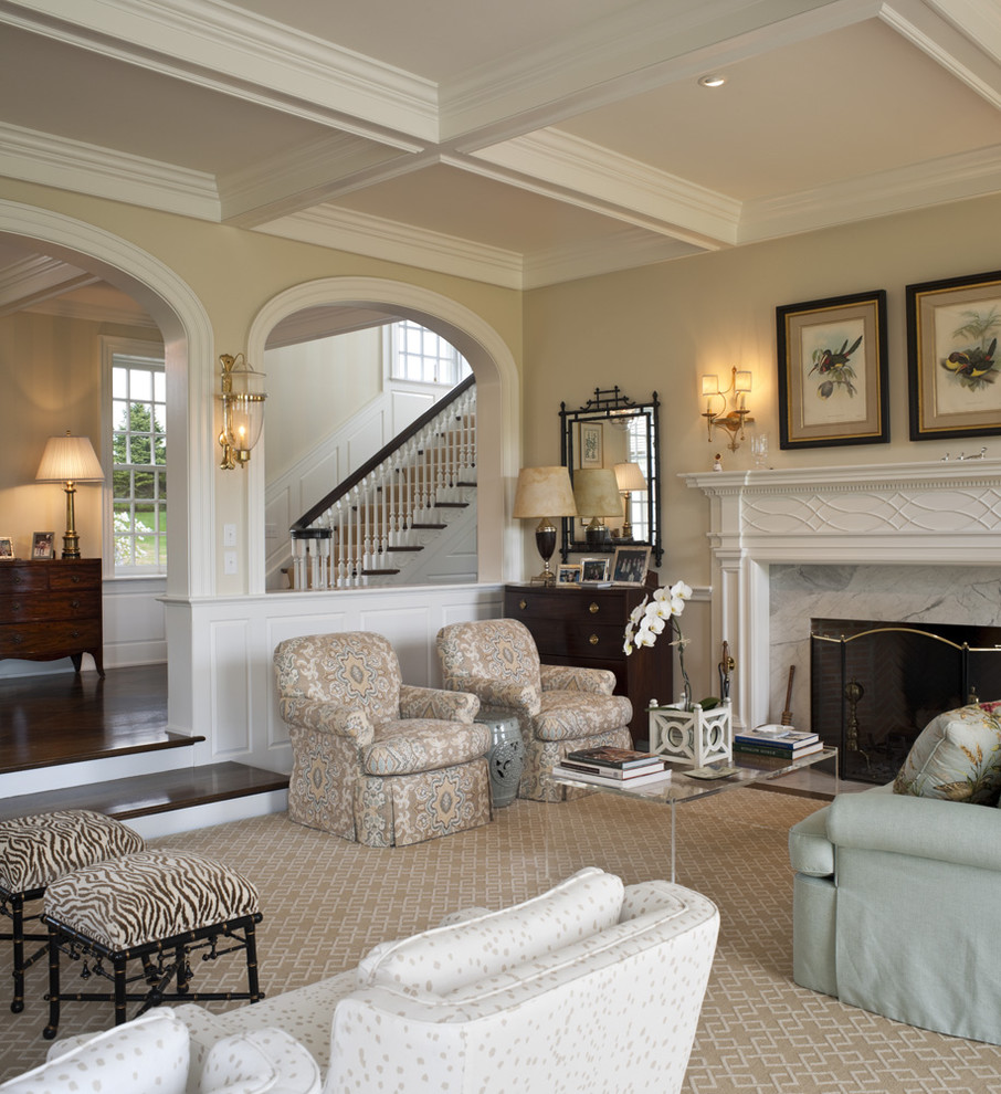 Example of a large classic formal and open concept carpeted living room design in Philadelphia with beige walls, no tv, a standard fireplace and a stone fireplace