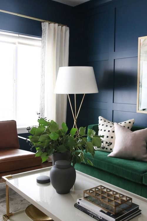 Example of a mid-sized transitional medium tone wood floor living room design in Salt Lake City with blue walls