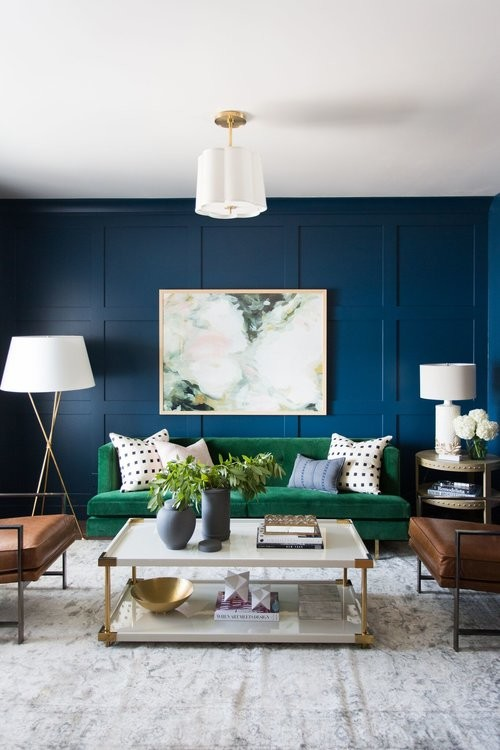 Mid-sized transitional medium tone wood floor living room photo in Salt Lake City with blue walls