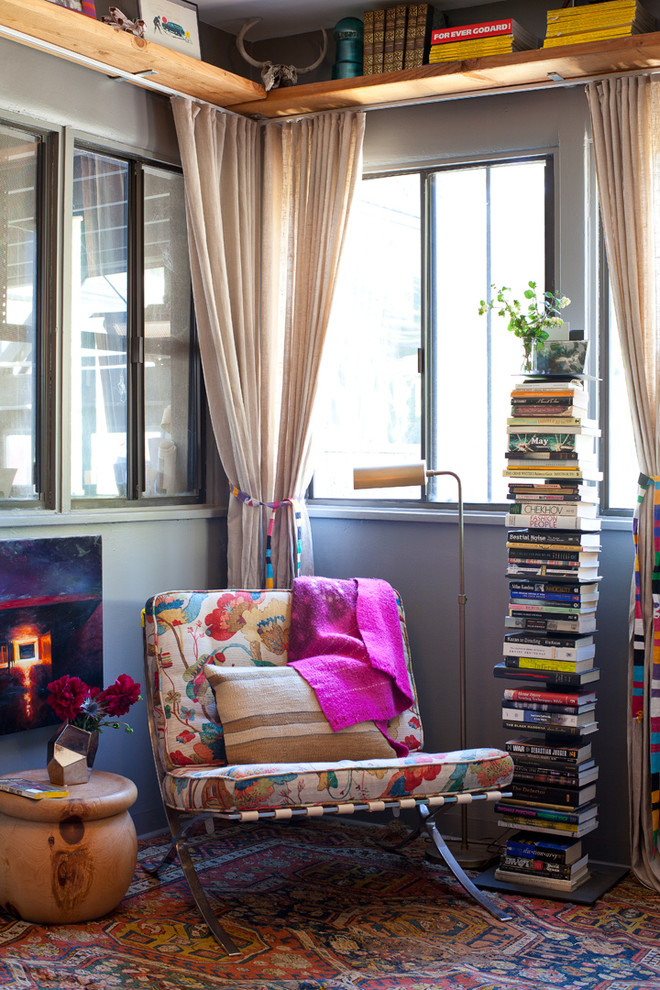 Example of an eclectic living room library design with gray walls