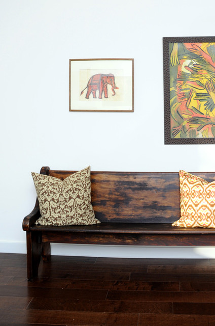 The Living Room Church vintage deacon's bench (church pew) with ikat pillows and oil