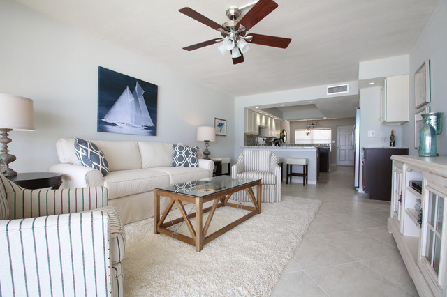 Vintage florida beach condo gets a transitional remodel beach style living room tampa by - Beach style living room ...