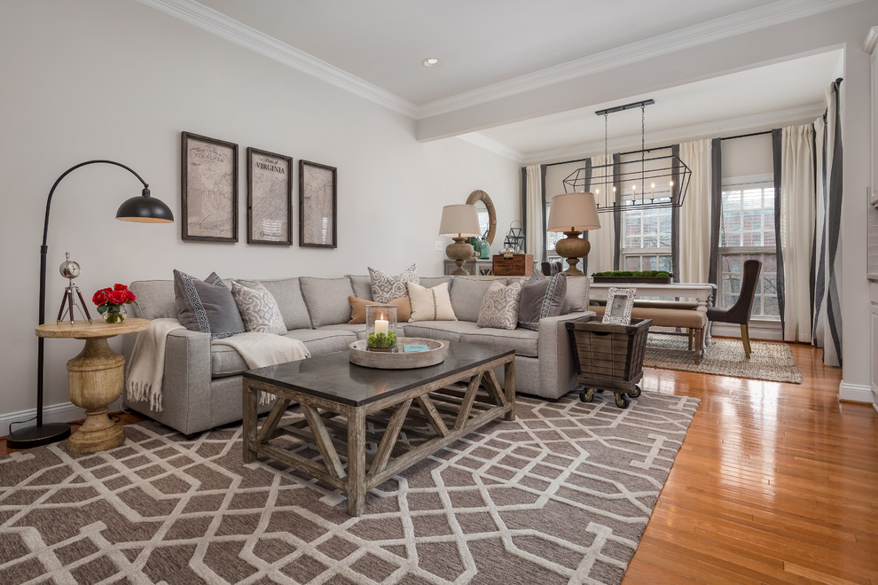 Cottage medium tone wood floor and brown floor living room photo in DC Metro with gray walls