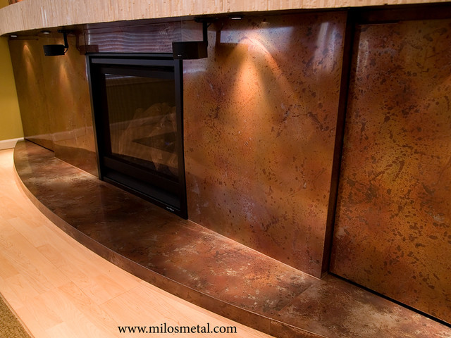 Volcanic Stainless Steel fireplace surround contemporary-living-room