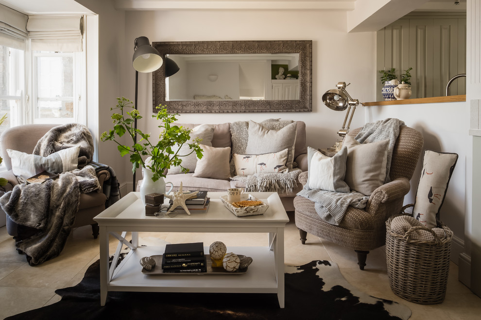 Example of a small beach style enclosed beige floor living room design in Dorset