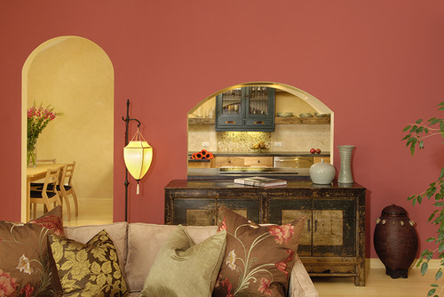 eclectic living room with bright coral wall.