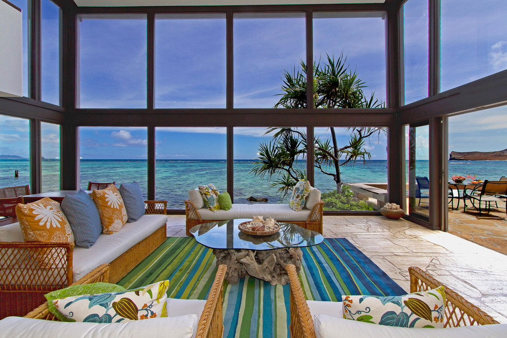 Example of a large beach style open concept and formal beige floor living room design in Hawaii with no tv