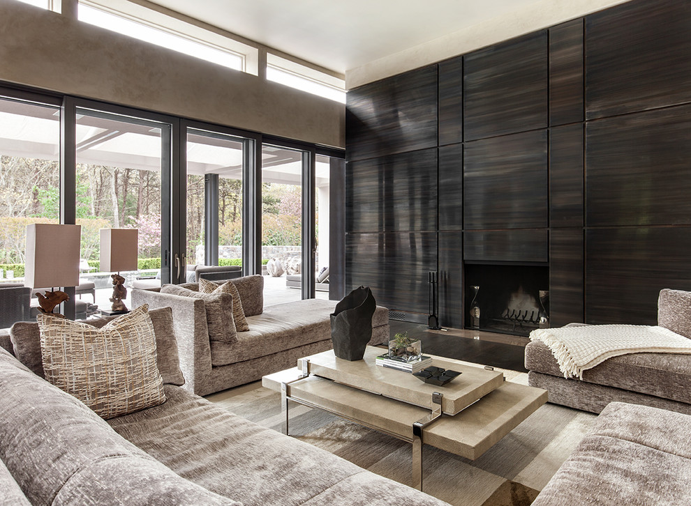 Living room - contemporary dark wood floor and brown floor living room idea in New York with brown walls and a standard fireplace