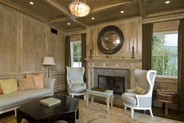 example of a classic living room design in los angeles with beige walls and a standard