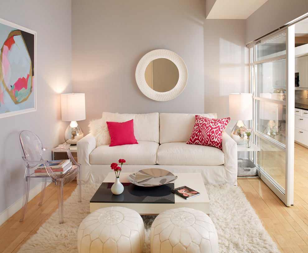 Example of a transitional formal and enclosed light wood floor living room design in Other with gray walls