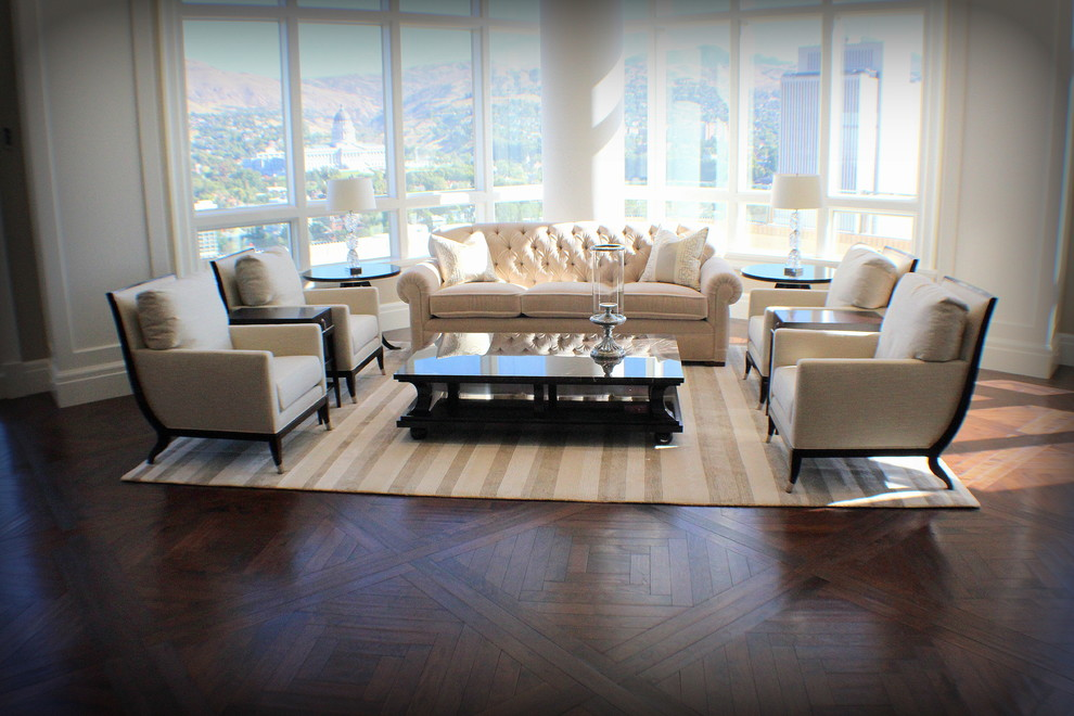 Example of a huge classic formal and open concept dark wood floor living room design in Salt Lake City with white walls, no fireplace and no tv