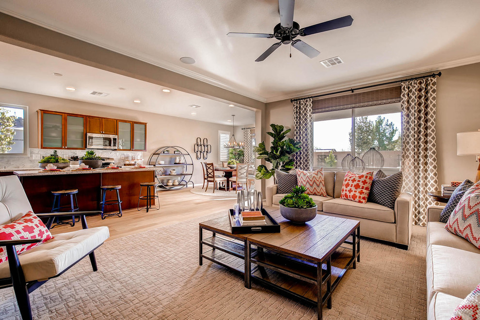 Example of a transitional formal and open concept light wood floor living room design in Las Vegas with beige walls