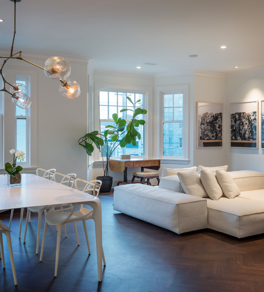 Living room - contemporary open concept dark wood floor living room idea in San Francisco with white walls