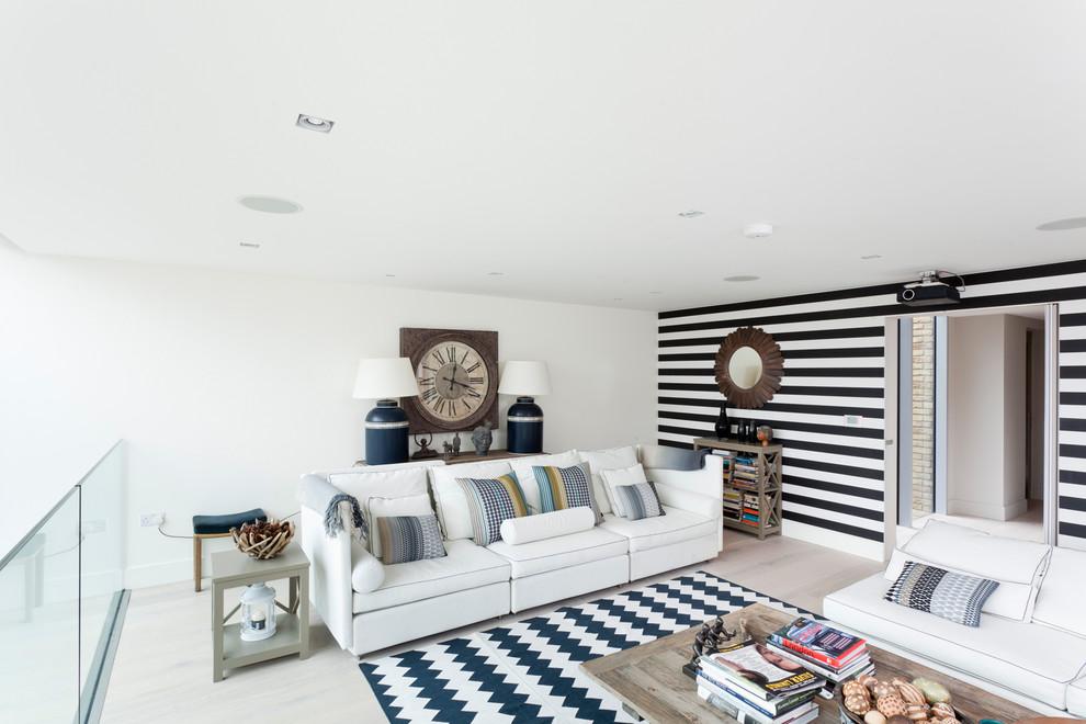 Danish loft-style light wood floor living room photo in Orange County with white walls